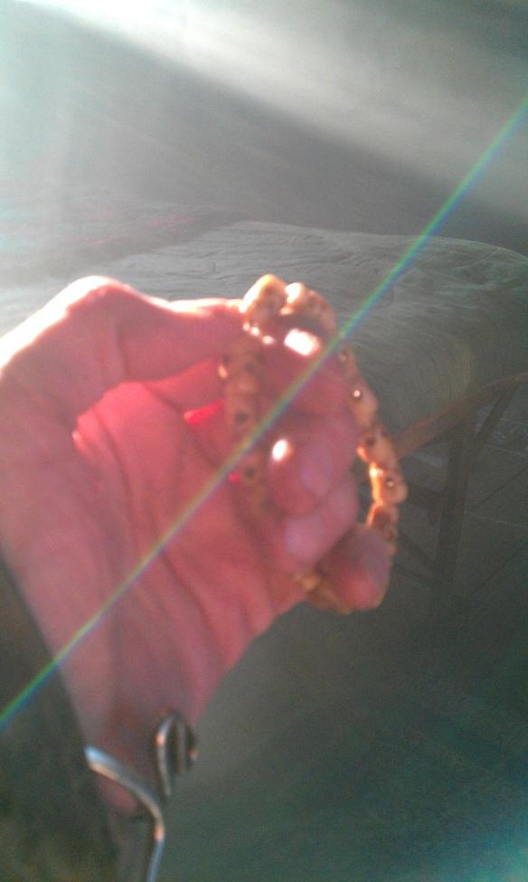 hand mala ray of light